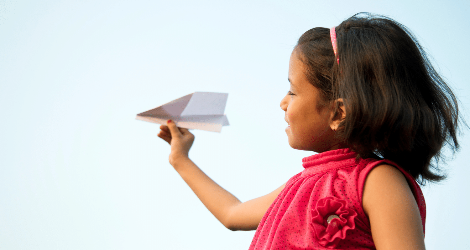 Young Girl with paper areoplane
