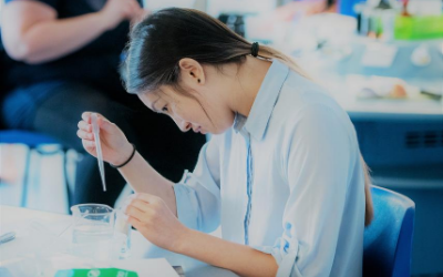 Young woman doing a science experiment